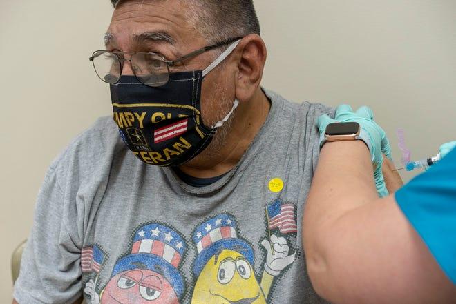 U.S. Army veteran Ramon Martinez receives the Moderna COVID-19 vaccine at a VA facility in February.