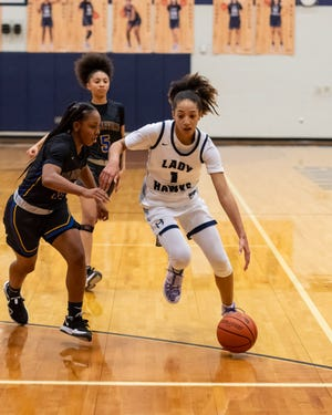 Zoe Nelson, left, and the Hendrickson girls basketball team lost to unbeaten Beaumont United Saturday in the Class 5A Region III semifinals.