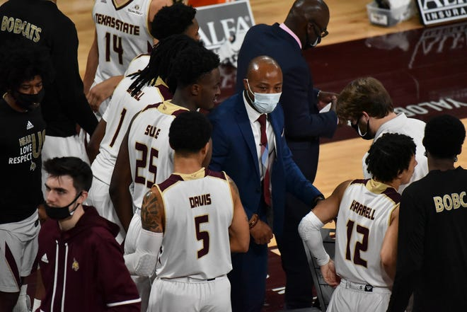 Texas State head coach Terrence Johnson speaks with players during a November game against the Mississippi State Bulldogs. Johnson guided the Bobcats to the Sun Belt regular season title this year, the first conference crown for the school since winning the Southland in 1999.