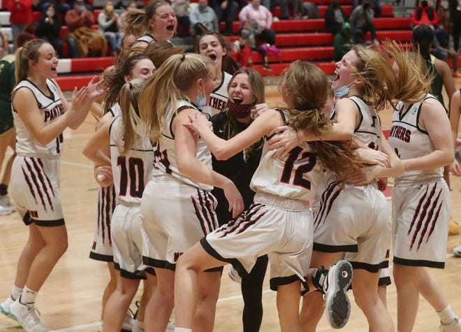 Norton celebrates its 58-47 victory over St. Vincent-St. Mary in a Division II district final Saturday night.  [Mike Cardew/Beacon Journal]