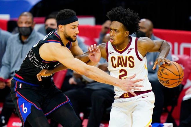 Cavaliers guard Collin Sexton, right, tries to get past Philadelphia 76ers forward Ben Simmons during the second half of the Cavs' 112-109 overtime win Friday night in Philadelphia [Matt Slocum/Associated Press]