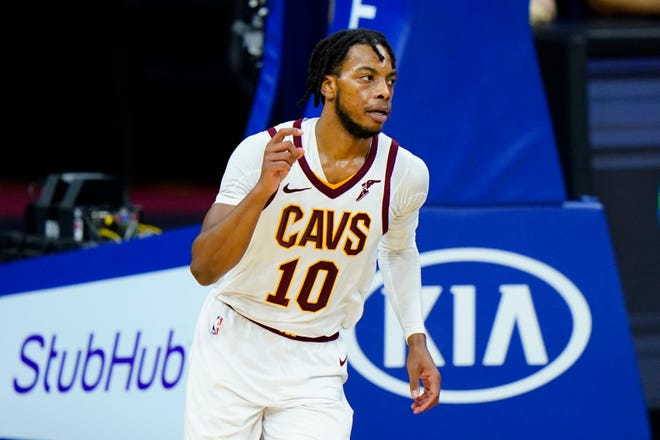 Cavaliers guard Darius Garland scored a career-high 25 points in a 112-109 overtime win over the Philadelphia 76ers on Saturday night and said it was fun having the trust of his teammates during the tough stretches of the game. [Matt Slocum/Associated Press]