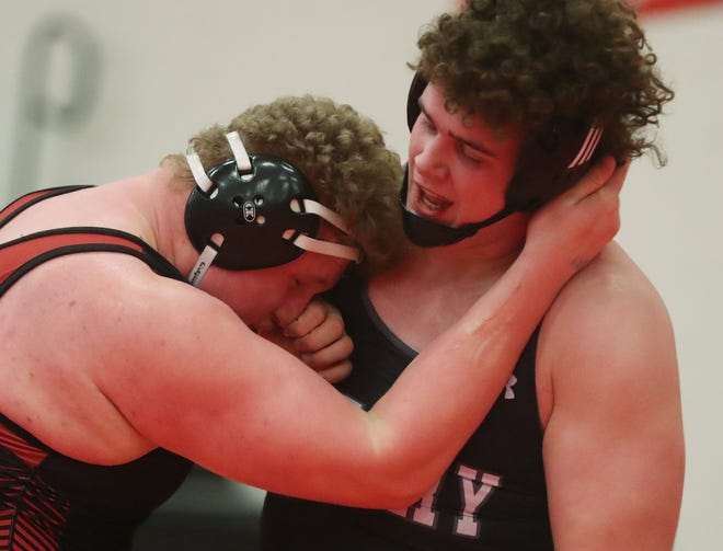 Wadsworth Aaron Ries (left) tangles with Perry's Aldan Fockler in the 285-pound weight class at the Division I wrestling sectionals at Wadsworth High School, Saturday Feb. 27, 2021. [Mike Cardew/Akron Beacon Journal]