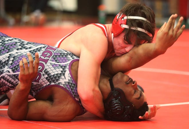 Wadsworth's Logan Messer controls Barberton's D.J. McNeil in the 170-pound weight class at a Division I wrestling sectional at Wadsworth. Messer won a sectional title. [Mike Cardew/Beacon Journal]