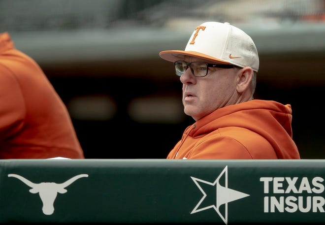 Texas head coach David Pierce watches his team play against Cal State Fullerton in March of last year in Austin. His Longhorns gave up five runs in the sixth inning on the way to losing the series finale to BYU.