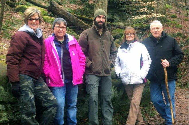 Kathy Hicks (far left) and Jordan Tackett (center) will be part of the newly formed Malabar Trails Team, which is seeking volunteers to help with trail maintenance at the park.