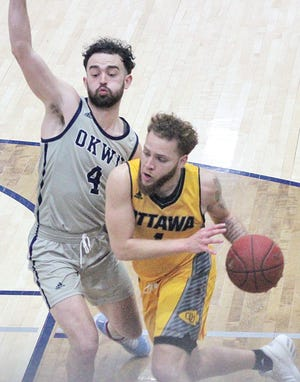 Oklahoma Wesleyan University's Lense Ramey, left, tries to put the defensive hammer down on an Ottawa University player during Saturday's showdown at OKWU.