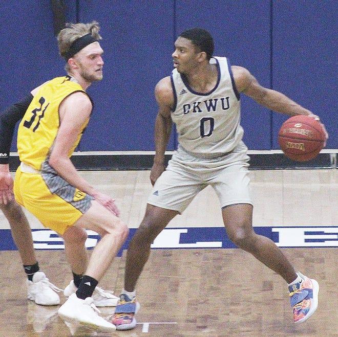 Oklahoma Wesleyan University guard Taylen Miller, right, challenges an Ottawa University defender during last Saturday's KCAC semfinal in Bartlesville