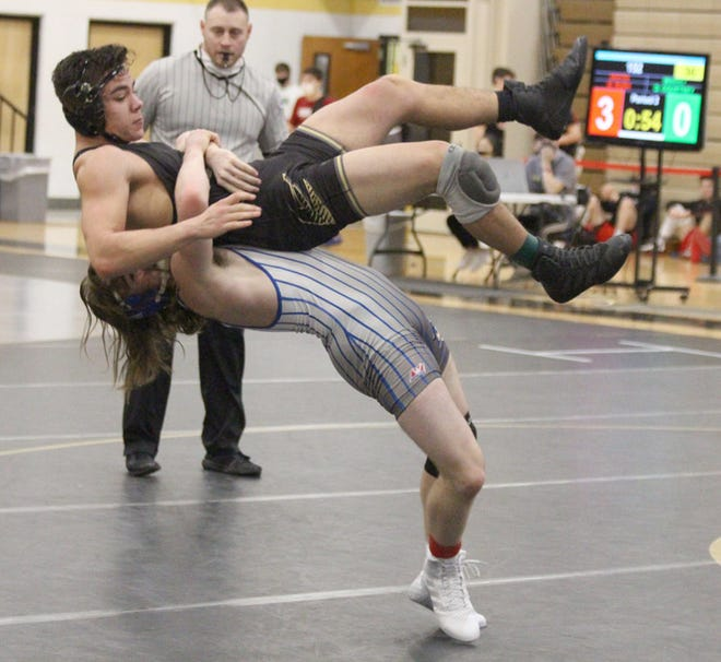 Boonville freshman wrestler Xavier Flippin lifts Savannah's Chase Hinton off the mat in a consolation match Saturday during the Class 2 Sectional 4 Tournament at Excelsior Springs High School. Flippin finished 0-2 in the 152 pound weight class.