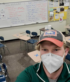 Matt Johnson, social studies teacher at Rock Bridge High School, has received both doses of COVID-19 vaccine, one of fewer than 20% of school district staff to receive vaccinations so far. Some teachers are feeling more comfortable with the idea of students returning to school five days a week.