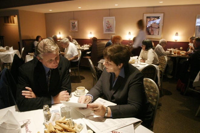 Thom Coffman, owner of the Clarmont and president of the Central Ohio Restaurant Association (CORA), meets with Gail Baker, executive director of CORA, over lunch at the Clarmont, in this file photo taken on Tuesday, October 19, 2004.