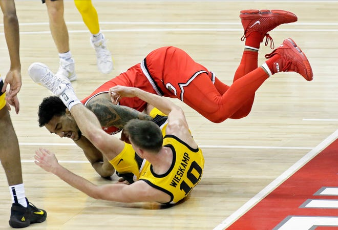 Ohio State Buckeyes guard Musa Jallow (2) and Iowa Hawkeyes guard Joe Wieskamp (10) chase a loose ball during Sunday's NCAA Division I Big Ten conference basketball game at Value City Arena in Columbus, Ohio, on February 28, 2021.