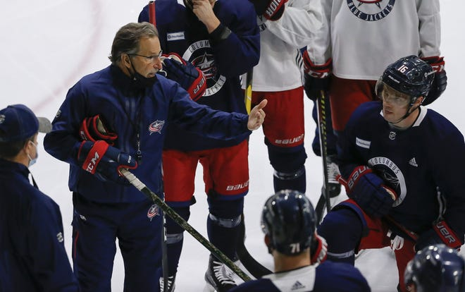 Blue Jackets coach John Tortorella, here at a practice on Jan. 5, can't wait until he gets to spend more time talking face-to-face with his players. NHL protocols call for all off-ice team meetings to be held virtually.