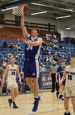 Cambridge senior Dominic Cork (34) goes up for two of his career high 32 points on Saturday to led the Bobcats to a 49-43 win over East Liverpool to capture the Division II sectional title.