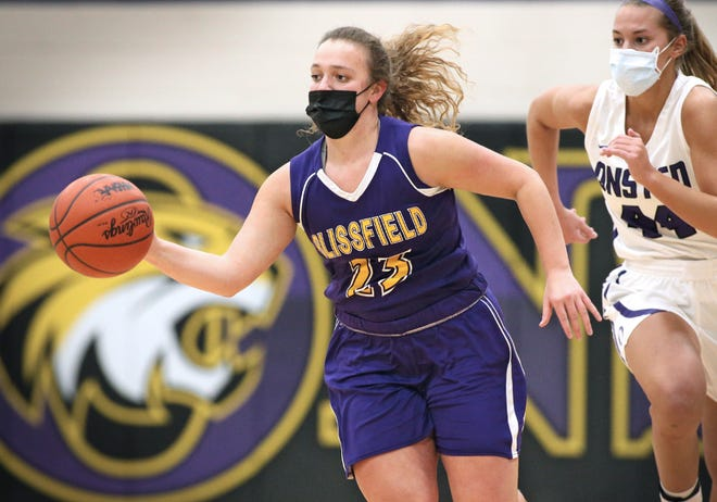 Blissfield senior Kara Stutzman (23) brings the ball up the floor while Onsted's Mya Hiram (44) pursues during an LCAA game at Onsted this year. Stutzman joined elite company on Saturday, scoring 22 points to push her over 1,000 points for her high school career.
