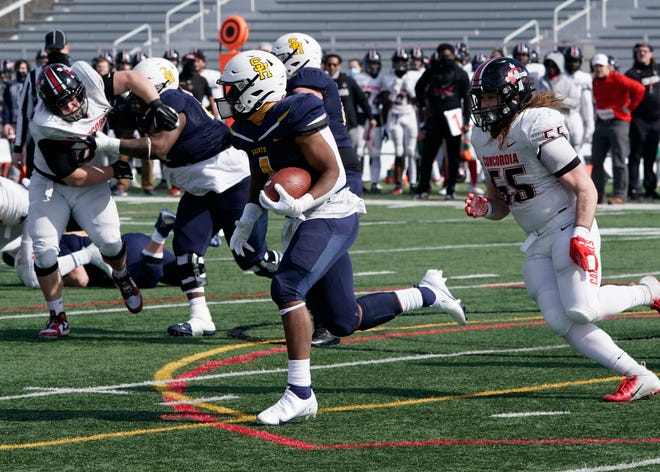 Siena Heights running back Jared Jordan (4) runs with the ball during Saturday's game against Concordia-Ann Arbor at O'Laughlin Stadium.