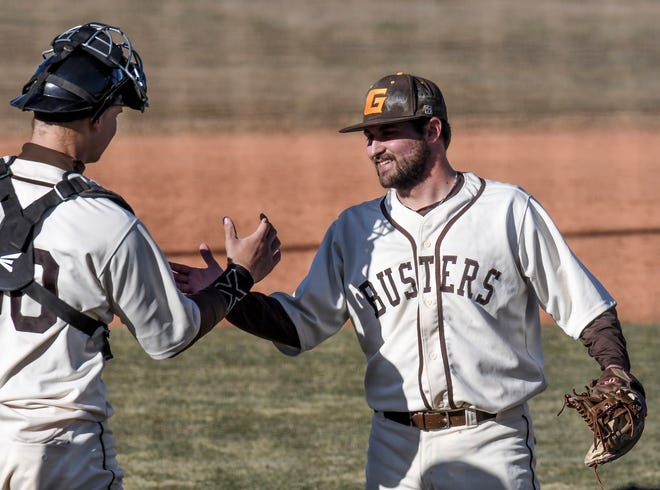 Garden City Community College pitcher Noah McCandless, right, is congratulated by catcher Geoff Marlow as the Broncbusters win the first game of a series with Colby, 12-8, on Saturday at Williams Stadium.  McCandless pitched the final two innings of the nine-inning game.