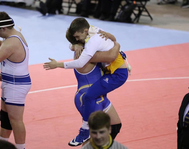 Brad Mahoney (right), who won the 170-pound state title, embraces Gavin Soniat (left) after he won the 285-pound state championship.