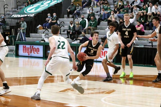 Fort Hays' Kaleb Hammeke drives into the lane against Northwest Missouri State Saturday at Bearcat Arena.