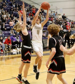 Whitewright's Aaron Pitt drives to the basket during a region quarterfinal contest against Paris Chisum.