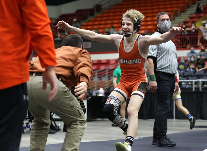 Abilene freshman Tucker Cell runs into the arms of coach James Stout after pinning Chanute's Kolton Misener in the 113-pound final of the Class 4A state wrestling tournament Saturday at Tony's Pizza Events Center in Salina.