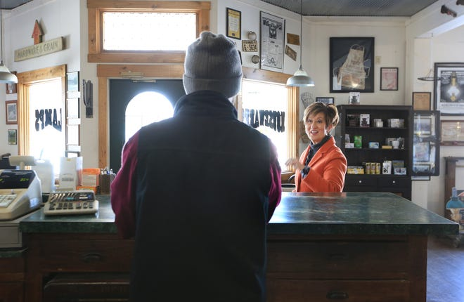 Customer Mary McCurry talks Yoder Hardware and Lumber Co. owner Delmar Eash about an item he repaired for her at the store.