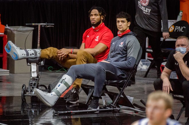 Bradley's Ja'Shon Henry, right, joins teammate Ari Boya on the sidelines with a walking cast in the second half against Drake on Saturday, Feb. 27, 2021 at Carver Arena in Peoria. Henry was injured in the first half.
