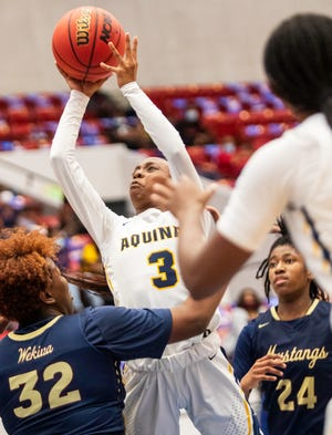 St. Thomas Aquinas' Samara Spencer goes up for a shot against Wekiva during the second on Saturday night in the championship game of the 2021 FHSAA Class 6A Girls Basketball State Championships at the RP Funding Center.