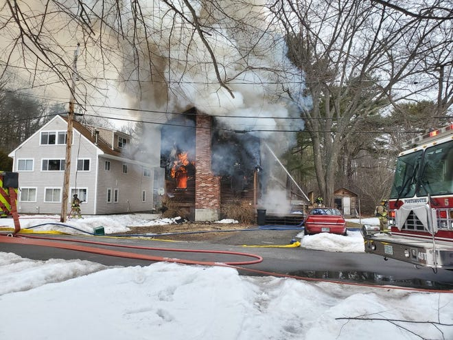 Firefighters battle a fire in the home at 7 Holland Drive in Rye Sunday, Feb. 28, 2021.