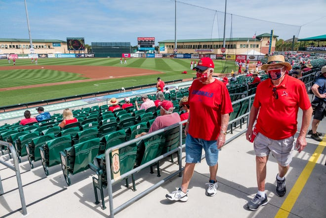 Fans make their way to their socially distant seats before Sunday's game at Roger Dean Chevrolet Stadium in Jupiter.