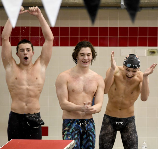 Hoover Boys celebrate the 400 freestyle relay in Boys Division I State Swimming at C.T. Branin Natatorium in Canton Saturday, February 27, 2021.