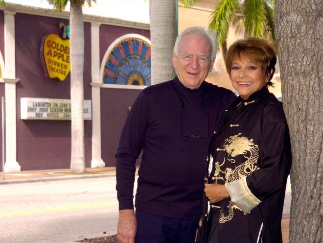 "A 2007 portrait of Robert Turoff and his wife Roberta MacDonald, outside the Golden Apple Dinner Theatre that they ran in downtown Sarasota for 42 years. After MacDonald died in 2015, Turoff started writing letters to her, which he has collected in ""Dear Roberta: letters to My Wife, A Golden Apple Memoir."" ("