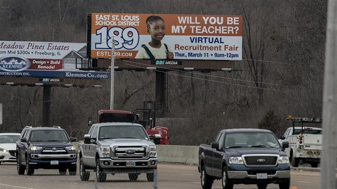 A billboard located along Illinois State route 15 in Centreville, Ill., advertises for teachers for East St. Louis School District 189.