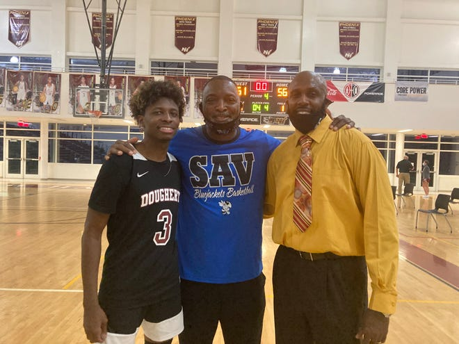 Bakari Bryant Sr. (right) with his son, Bakari Bryant Jr. of Dougherty High, and Savannah High coach Tim Jordan.