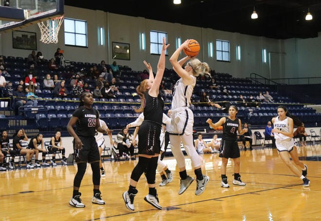 Shawnee's Aubrie Megehee puts up a jumper against the Ardmore Lady Tigers Saturday in a Class 5A regional title game at the SHS Performing Arts and Athletic Center.