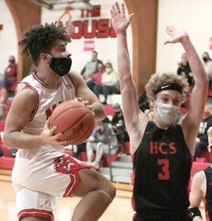 Kaleb Johnson of Colon heads in for two points against Howardsville Christian on Saturday evening.