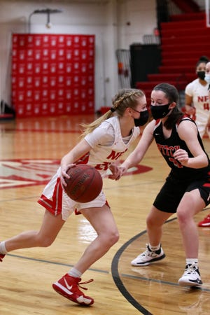 NFA senior guard Sarah Ericson takes the ball upcourt against  Fitch's Katelyn Cervini during the Wildcats win at NFA.