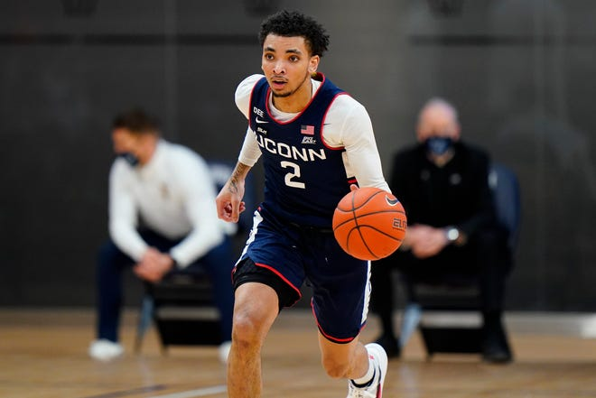 UConn's James Bouknight helped the Huskies defeat Marquette on Saturday in Storrs. He scored a team-high 24 points in the 80-62 win.