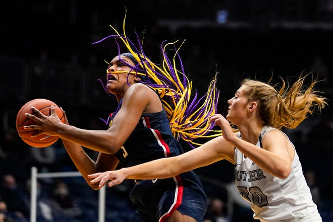 UConn forward Aaliyah Edwards (3) grabs a rebound in front of Butler guard Jaia Alexander (20) during the fourth quarter of an NCAA college basketball game in Indianapolis, Saturday, Feb. 27, 2021.
