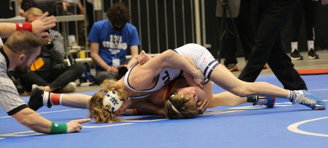 Washburn Rural's Bishop Murray turns Lawrence's Kevin Honas for back points during their 120-pound title match Saturday at the Class 6A State Championships at Hartman Arena. Murray won 9-2 for the third state title of his career.