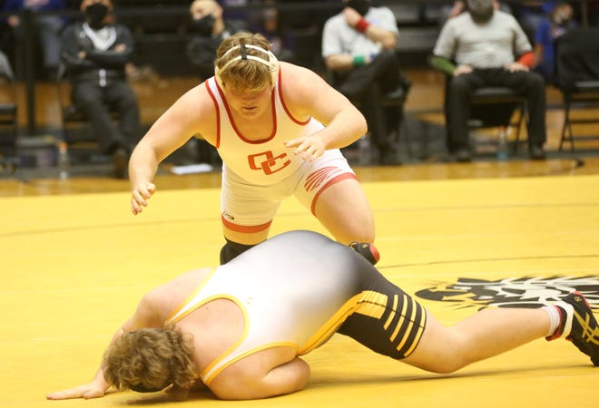 Osage City's Dane Whalen pounces on Mission Valley's Nolan Parker in the 285-pound Class 3-2-1A final on Saturday at Gross Memorial Coliseum.