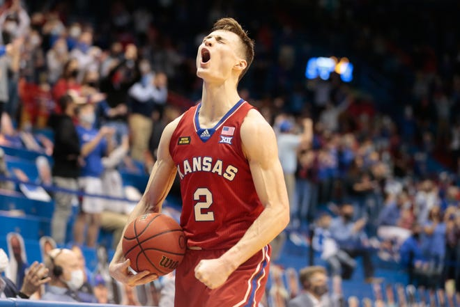 Kansas guard Christian Braun yells out after the Jayhawks pull ahead of Baylor during a game last season inside Allen Fieldhouse.