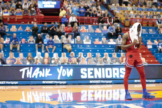 Kansas guard Marcus Garrett tears up during a Senior Day speech following the Jayhawks' game against Baylor last Saturday at Allen Fieldhouse in Lawrence. Garrett scored 14 points and grabbed seven rebounds in the Jayhawks' 71-58 victory.
