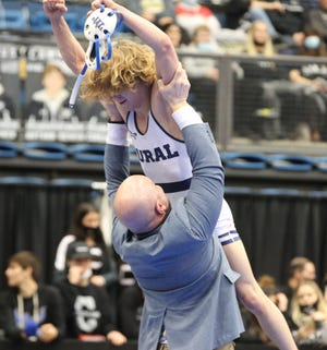 Washburn Rural's Bishop Murray is hoisted in the air in celebration by coach Damon Parker after capturing the 120-pound state championship Saturday at the Class 6A State Tournament at Hartman Arena. The title was the third of Murray's career and helped the Junior Blues win the first state title in program history.