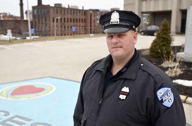 Worcester Police Officer Tim Foley outside headquarters Sunday.