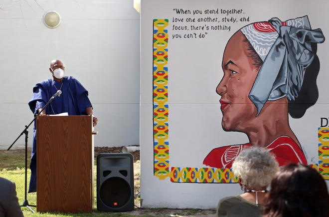 Kenneth Nunn, husband of 30 years to the late Dr. Patricia Hilliard-Nunn, speaks during the Dr. Patricia Hilliard-Nunn Mural Dedication and Tour on Sunday at the Martin Luther King, Jr. Multipurpose Center in Gainesville. [Lauren Witte/Special to The Sun]