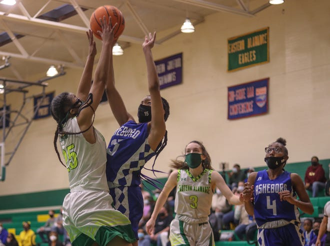 Eastern Alamance guard Hali Watkins collides with Asheboro forward Sion Murrain in a battle for a rebound.