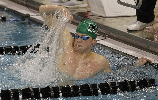 Dublin Coffman's Zac Stump celebrates after winning the 500 freestyle in the Division I state meet Feb. 27 at Branin Natatorium in Canton.