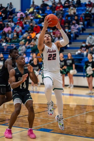 Waxahachie senior CJ Noland (22) goes in for a basket during Saturday's Class 6A Region II quarterfinal game against No. 9-ranked Killeen Ellison at Robinson High School, Noland, an Oklahoma signee, scored 22 points in the Runnin' Indians' 78-67 win.