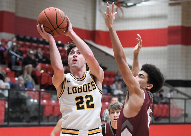Cisco's Stephen Bird goes for a shot against Seymour in a Region II-2A quarterfinal Saturday at Tiger Gym in Anson.